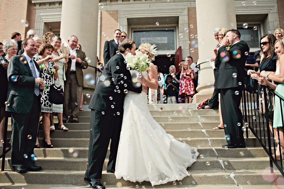 Bride and Groom exit the church in Lincoln Nebraska