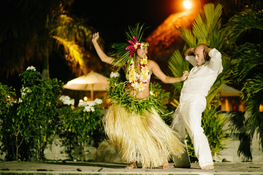 Groom dances with Tahitian hula dancers on Moorea