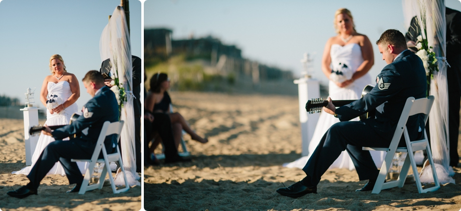Grooms plays guitar on the beach to bride