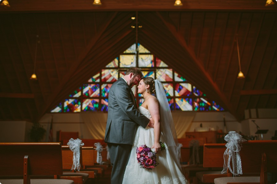 Portrait in front of stained glass at Wedding Photography Omaha Henry Doorly Zoo - Melissa and Todd